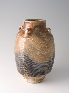 Tatsuzo Shimaoka, Vase with lugs, rope and slip inlay with natural ash and cobalt blue salt glaze, stoneware, 10.5 x 7 x 7""