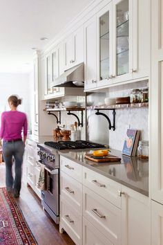 The House Diaries: White cabinets, shelves under cabinets, contrast of white and wood tones, steel, and stone