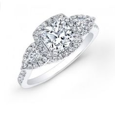 This diamond engagement ring can feature either a Princess or Cushion Cut center stone. With a diamond encrusted shank and bridge that is complemented with a halo and flanked by two Pear Shape side stones, this ring has a big look for a great price. 0.54ctw with any size center stone.