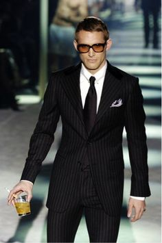 Great look. Love the cocktail and cigarette on the catwalk.