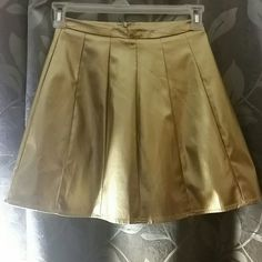Faux leather gold skirt Worn twice, great condition, purchased from once upon a skirt boutique. Will provide more pics if u like Skirts