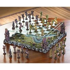 Fanciful Fairy Chess Set Home Decor - In the legendary world of Faerie, the armies of two ancient kings gather for a mythical battle. Across the fields and woods they march, matching wits and force as players in the age-old classic strategy game of chess. This Fanciful Fairy Chess Set Home Decor is sure to be the envy of all, with a clear etched-glass board suspended above a lifelike sculpted landscape.