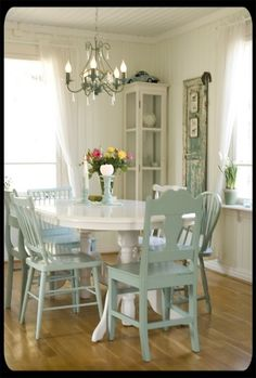white table with aqua chairs