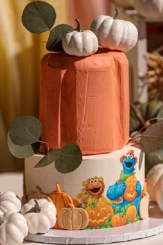 Take a look at the wonderful tiered cake decorated with Sesame Street characters and topped with pumpkins at this Fall Pumpkin Sesame Street party. See more party ideas and share yours at CatchMyParty.com