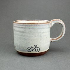 Variety of small and larger mugs. Nothing too massive, but handmade ceramic! Check out Jude Bryant's ceramics in VT too. Blue Ceramic Mountain Bike Mug by JuliaSmithCeramics on Etsy Ceramic Cafe, Ceramic Mugs, Stoneware, Pottery Mugs, Ceramic Pottery, Crackpot Café, Pimp Your Bike, Sculptures Céramiques, Kintsugi