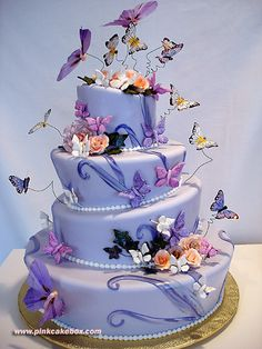 Culinary arts cake with flowers and butterflies from deviantART via weheartit.com