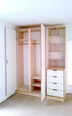 Plywood and white laminate bespoke wardrobe by Lozi. Lozi offers a fantastic selection of fitted wardrobes and can design and fit your perfect one. All our wardrobe designs are completely tailored to fit your needs, from adapted storage through to the choice of materials.