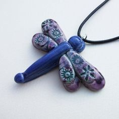 This beautiful double dragonfly is made from white earthenware clay and decorated in lovely, rich, blue and purple crystaline glazes click now for info. Ceramic Pendant, Ceramic Jewelry, Ceramic Beads, Clay Beads, Clay Jewelry, Jewellery, Dragonfly Jewelry, Dragonfly Pendant, Polymer Clay Projects