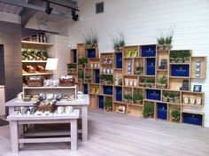 LOVE the crates piled against the wall for shelving