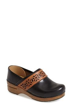 Free shipping and returns on Dansko 'Pavan' Heritage Clog (Women) at Nordstrom.com. Gorgeous cutwork pretties up a marvelously comfortable clog outfitted with a contoured footbed that offers optimal arch support and set on an antifatigue rocker sole with a natural woodgrain finish.