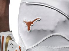Texas Football will wear special uniforms designed by Nike for the 2013 AT&T Red River Rivalry. The burnt orange Longhorns logo is displayed on the hip of the pant.