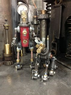 Robot and his dog taking a stroll. Metal art, assemblage art, welded art.