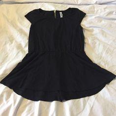 Target Xhilaration Peplum Shirt Black peplum shirt from Target! Fits an XS perfectly. Features a gold back zipper! Xhilaration Tops Tees - Short Sleeve