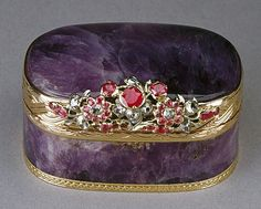 Rectangular hinged amethystine quartz snuff box, mounted with gold rim and base tooled with guilloché decoration, large floral thumbpiece of gold set diamonds and rubies. Interior solid amethystine quartz with beautifully moulded base. c1770. Belonged originally to Princess Sophia, daughter of George III of England and his wife, Charlotte. #antique #vintage #box