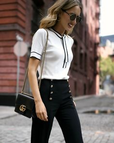 NYC fashion blogger white tie neck knit top with black piping navy sailor inspired button front pant classic Gucci leather crossbody bag round large sunglasses