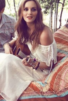 Leighton Meester is adorable playing a guitar in her cute white boho dress. She needs to do more movies!