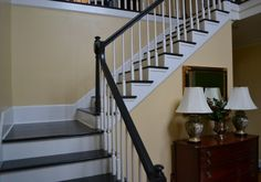 A Before and After from carpeted stairs to painted stairs.