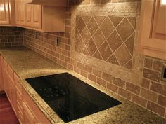 Backsplash - simple over the stove design, but I don't like the stone look of the subway tile