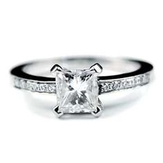 Princess Cut.  This is the most perfect ring that I have ever seen! I am in love!!!