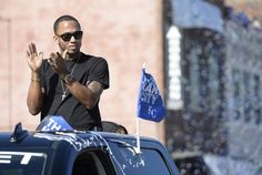 Royals shortstop Alcides Escobar rode the parade route to greet Royals fans that lined Grand Boulevard during the World Series victory parade on Tuesday, Nov. 3, 2015 in Kansas City.