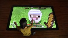 """Witness the next evolution in large scale gaming! Playing Minecraft on our 86""""Colossus gives gameplay a big boost. Look at the size of those controls! Get lost in the landscape with Ultra HD resolution.  Prequel video for Minecraft on one of our coffee tables can be found here. Visit our website to find more about our multitouch tables and touch walls."""