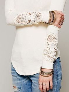 shirt with crochet insert on sleeves.