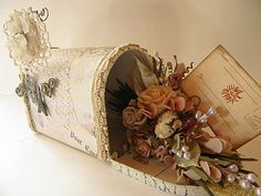 Vintage-styled altered mailbox using dried flowers, pale colors (beige, grey, pinks)