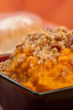 Recipe including course(s): Side; and ingredients: egg, flour, granulated sugar, light brown sugar, milk, pecan, salt, sweet potato, unsalted butter, vanilla extract