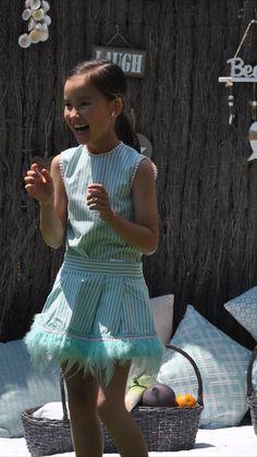 #Vestidoniña firma #lolittos en talla 5.  Lolittos nos presenta un conjunto de #blusa y #falda súper original para un evento importante. Sus tonos turquesas y blancos son muy favorecedores y además ambas piezas están llenas de detalles de lo más originales. En este caso, la blusa de rayas tiene una espalda espectacular. Ambas piezas se venden por separado. #modainfantil #tiendaropaintantil #vestidosniña #outfit Overall Shorts, Overalls, Women, Fashion, Child Fashion, Blouse And Skirt, Turquoise, Originals, Girls Dresses