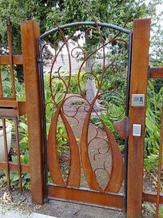 whimsical garden | Whimsical rusty scrolly gate | Decorative Metal.