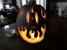 Flame Face - Pumpkin painted flat black then carved. - Halloween Pumpkin - Jack-o-lantern