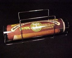 Pyrex Bread Bake A Round by Corning Glass. Comes complete with Tube, Holder, Original Recipes, in the Box.