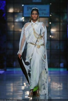 A model walks the ramp for designer Satya Paul on Day 3 of Delhi Couture Week held in New Delhi on August .