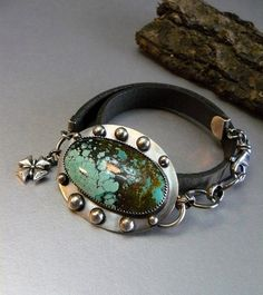 This unique ooak piece is made with a beautiful bright natural green turquoise that measures 38x22mm and is set on a 46x36mm oxidized sterling silver