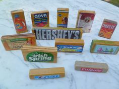 Play Kitchen Accessories: Wooden Groceries Part 7  Decoupage labels onto wooden blocks or wood scraps.