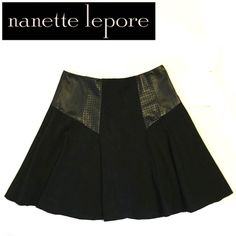 "💞NWOT Nanette Lepore ""Coyote"" skirt- leather trim ✨The ""coyote"" skirt. Girly and edgy- and ulta-flattering! If you're looking for the perfect black skirt: You found it✨  🔹Brand: Nanette Lepore 🔹Size: 4 🔹Color: Black 🔹Solid & perforated leather accents 🔹Length: 18 3/4"" 🔹Width: Waist measures about 14.5"" (29"" around)-some stretch 🔹Closure: Exposed back zip & inside button 🔹Fabric: Viscose/Nylon/Elastane (stretch) 🔷Combo: 100% Leather 🔹Fully lined: Polyester 🔹Care: Dry clean 🔹Brand…"
