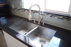 Black Galaxy granite, glass backsplash, stainless sink