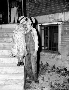 Thirty-four-year-old mountaineer Homer Peel kisses his bride Geneva on the courthouse steps at Madisonville, Tenn., June 25, 1937, after he was told by the court that he could keep his 12-year-old wife. Peel testified he married the child after his efforts to get her into an orphanage proved unavailing. (AP Photo)