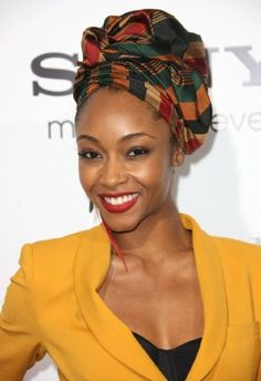 head wrap, yellow coat, red lip