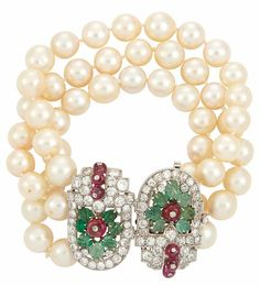 Triple Strand Cultured Pearl Bracelet with Platinum, Diamond, Carved Emerald and Ruby Bead 'Tutti Frutti Clasp Pearls ap. 9.0 to 8.6 mm., 66 old-mine cut diamonds ap. 4.60 cts., 14 carved emeralds, 8 ruby beads, clasp originally clips, c. 1930.