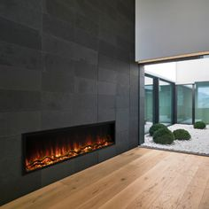 Check out www.burlingtonfireplace.com for more inspiration on fireplaces & heating upgrades. Tiled Fireplace Wall, Linear Fireplace, Basement Fireplace, Home Fireplace, Fireplace Remodel, Living Room With Fireplace, Modern Fireplace Tiles, Midcentury Modern Fireplace, Fireplace Feature Wall