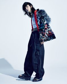 Sofia wears coat Preen by Thornton Bregazzi. Top stylists own. Jeans and necklace BESS. Sandals Amelia Lindquist