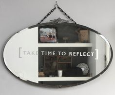 'Take time to reflect' mirror by Vinegar and Brown Paper. Well, not upcycling as such, but reinvention.
