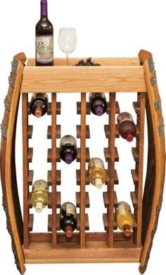 This custom-made Narrow Wine Rack has room to hold all of your favorite bottles. Two vintage French-oak wine-barrel ends, solid-hardwood panels and solid-oak shelf top. Made in USA. Wine Barrel Table, Wine Barrel Furniture, Home Bar Decor, Pub Decor, Unique Wine Racks, Oak Shelves, Bottle Rack, Wine Collection, French Oak