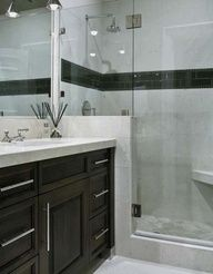 Small bathroom idea. Minus the black stripe..... Agree abt the stripe. Like the vanity butted to the shower enclosure.