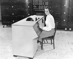 Technician preparing a data report on a Differential Analyzer 1951 [3000 x 2400]