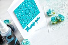 Layered embossing paste colored with sprays applied through Altenew Kaleidoscope stencils. Card by @craftwalks.