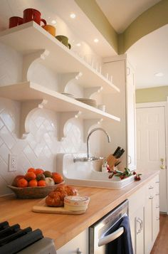 traditional kitchen by Four Brothers LLC.  nice herringbone tilework. Kohler sink, butcher countertop
