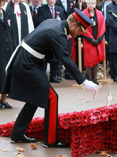 Prince Harry places a cross during a Service in the Field of Remembrance at Westminster Abbey on November 5, 2015 in London, England.