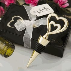Size 4 x 1 Gold double heart design all metal bottle stopper Made from metal with a shiny gold plated finish. Top has a double heart design Heart attached to gold plated metal bottle stopper. Stopper has black rubber gasket for a t. Italian Wedding Favors, Wine Wedding Favors, Wedding Shower Favors, Wine Favors, Wedding Gifts, Wedding Cakes, Wine Tasting Near Me, Wine Bottle Design, Engagement Favors